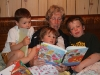 The kids reading with their grandma